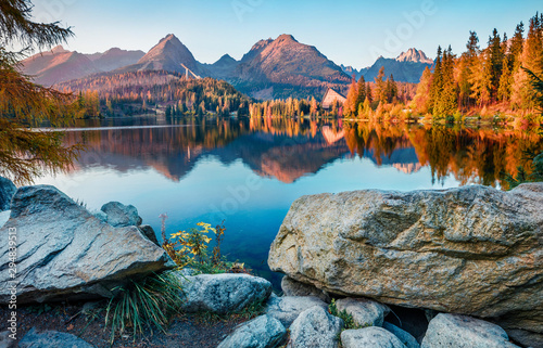 Foto auf Gartenposter Baume Exciting autumn view of Strbske pleso lake. Gorgeous evening scene of High Tatras National Park, Slovakia, Europe. Beauty of nature concept background.