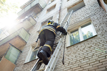 Fireman Climbs Stairs Up In Burning Brick House