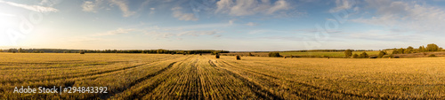 Haystacks on the field in autumn season with cloudy sky. Wallpaper Mural