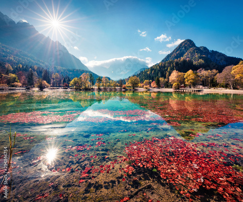 Foto auf Gartenposter Dunkelbraun Gorgeous morning view of Jasna lake. Stunning autumn scene of Julian Alps, Gozd Martuljek location, Slovenia, Europe. Wonderful landscape of Triglav National Park. Traveling concept background.