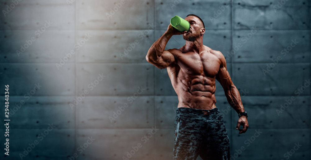 Fototapety, obrazy: Nutritional Supplement. Muscular Men Drinks Protein, Energy Drink After Workout