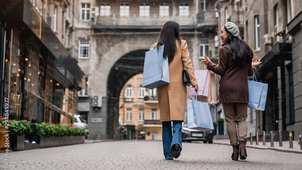 Fototapety, obrazy: Rear view full length shot of female friends out for shopping in the city