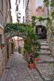 Fototapeta Perspektywa 3d - Monte San Biagio, Italy, 03/24/2018. A street among the old houses of a village in the Lazio region.
