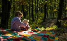 Boy Cute Child Play With Teddy Bear Toy Forest Background. Child Took Favorite Toy To Nature. Picnic With Teddy Bear. Hiking With Favorite Toy. Little Tourist. Happy Childhood. Inseparable With Toy