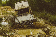 Mud And Water Splash In Off The Road Racing. Tracks On A Muddy Field. Off-road Vehicle Goes On Mountain Way. Expedition Offroader. Jeep Crashed Into A Puddle And Picked Up A Spray Of Dirt.