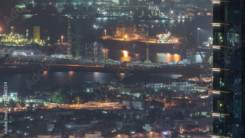 Aerial view from Downtown of Dubai to port night timelapse Fototapeta