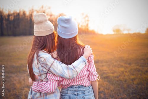 Obraz na plátně  Two best friends looking on sunset outdoors