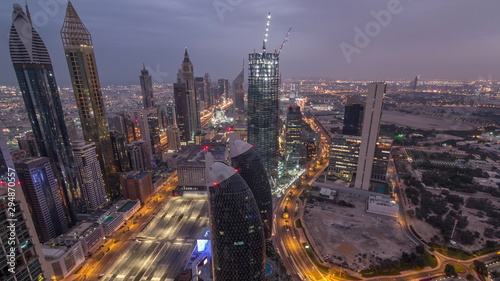 Foto auf Leinwand Lavendel Skyline of the buildings of Sheikh Zayed Road and DIFC aerial night timelapse in Dubai, UAE.