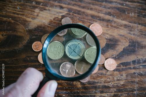 Photo magnifying glass over a euro coin