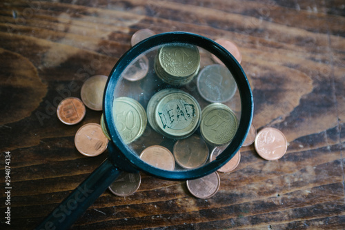 magnifying glass over a euro coin Canvas Print