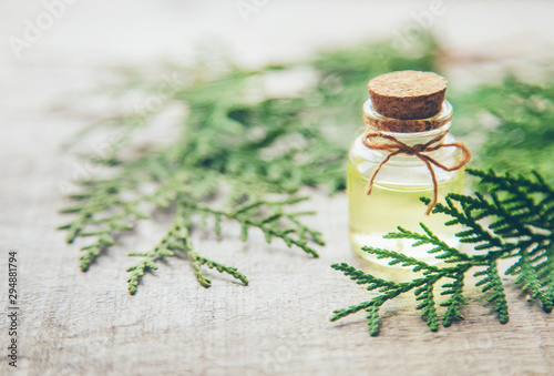 Juniper essential oil in a small bottle. Selective focus. Canvas