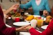 Leinwanddruck Bild - Family holding hands on thanksgiving event