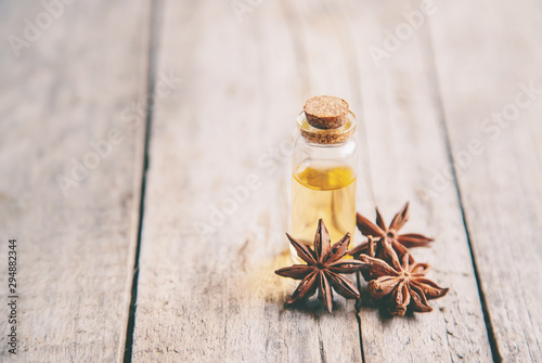 Star anise oil in a small bottle. Selective focus. Wallpaper Mural