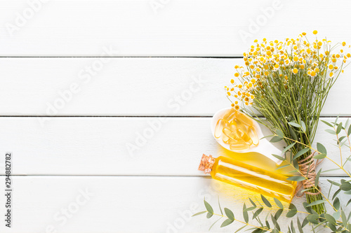 Poster Spa Beauty and fashion concept with spa set on pastel rustic wooden background.