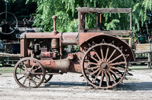 Close Up View Of An Old, Rusty, Abandoned Tractor.