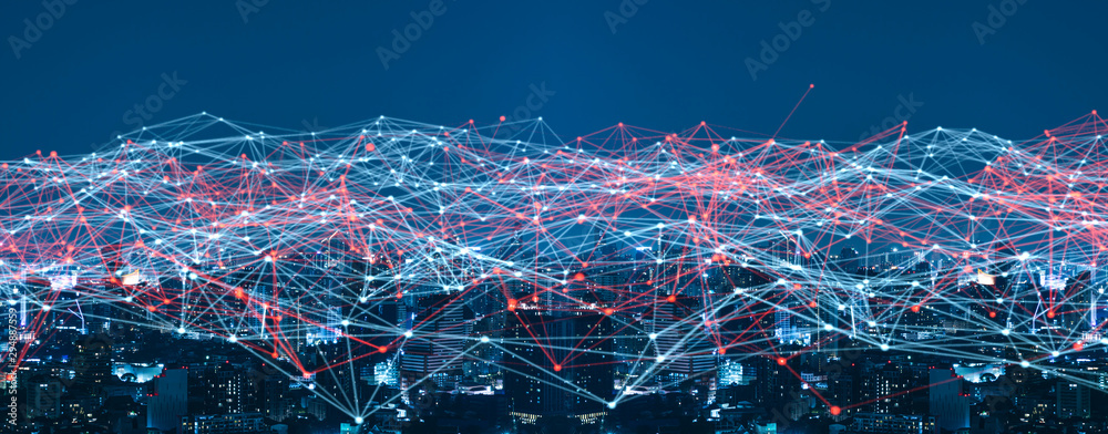 Fototapeta Smart city and Wireless communication network concept.abstract line connection on night city background.IoT(Internet of Things). ICT(Information Communication.