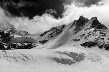 Man descending the Gran Paradiso glacier during winter on the north west side. The peack is the tallest mountain entirely in the italian territory.