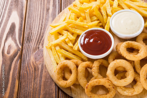 Fototapeta French fries and onion rings with sauces obraz