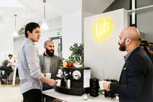 Men Getting Coffee In Office