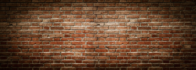 Old wall background with stained aged bricks