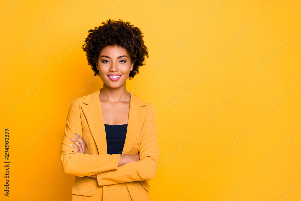 Fototapeta Portrait of her she nice well-dressed attractive lovely luxury pretty content cheerful cheery wavy-haired girl folded arms isolated over bright vivid shine vibrant yellow color background