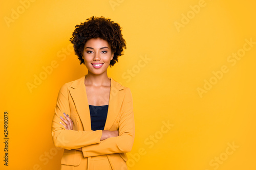 Portrait of her she nice well-dressed attractive lovely luxury pretty content cheerful cheery wavy-haired girl folded arms isolated over bright vivid shine vibrant yellow color background