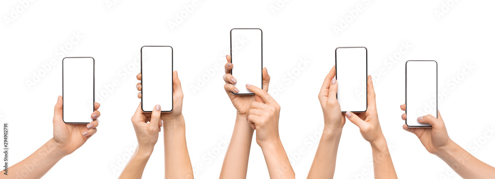 Fototapeta Woman's hands using smartphone with blank screen over white background