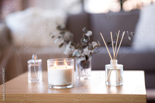 Tablou Canvas decoration, hygge and aromatherapy concept - aroma reed diffuser, burning candle