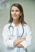 Portrait Of Confident Female Doctor Behind Windowpane