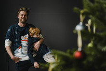 Father And Son Having Fun Together At Christmas Time