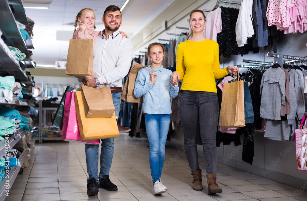 Fototapety, obrazy: Cheerful family walking in store after shopping