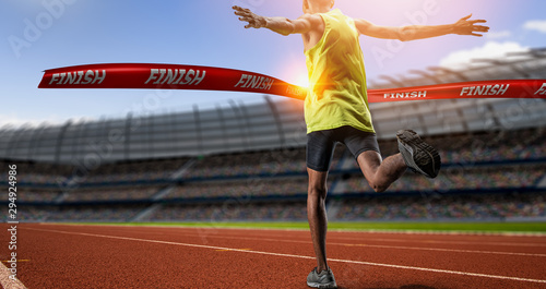 Winning young male Athlete crosses the finish line. Canvas Print