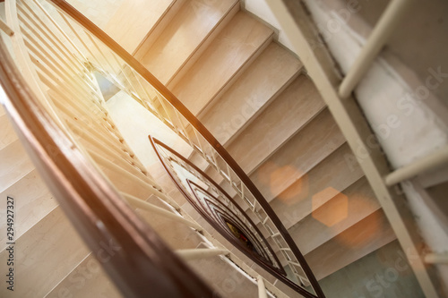 view from above modern staircase with marble luxury steps circular shape