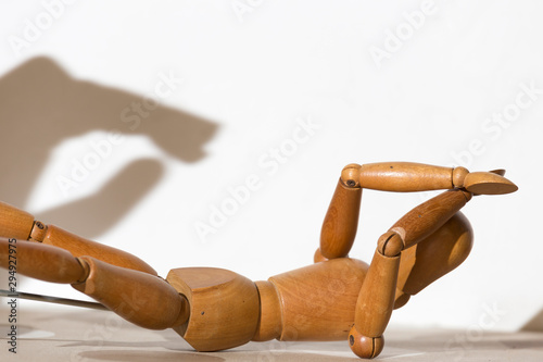 articulated doll in what appears to be a fight Wallpaper Mural