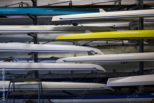 Stacks Of Gleaming White Crew Rowing Shells In A Boathouse Canvas Print