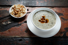 Traditional Turkish Yogurt Soup With Croutons Aside Isolated On Rustic Wooden Table