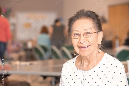 Smiling Hispanic Woman in a Senior Center Canvas Print
