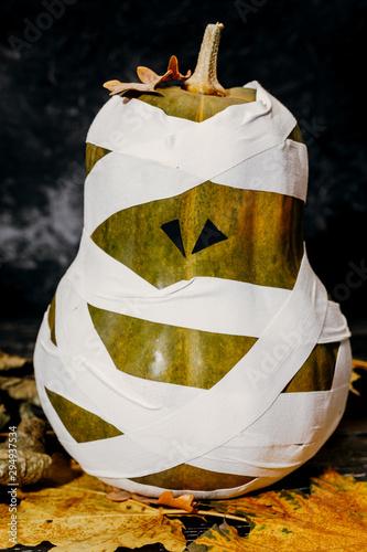 Fotografering Zombie pumpkins in bandages, on a dark background