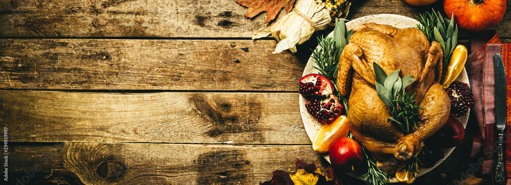 Fototapeta Selection of traditional thanksgiving food - turkey, mashed patatoes, green beans, apple pie on rustic background