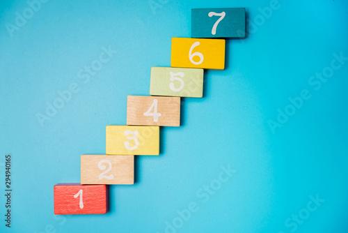 Fototapeta colored cubes with numbers on a blue background obraz na płótnie