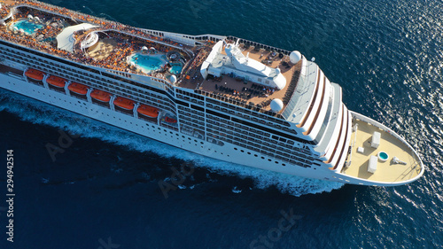 Fototapeta Aerial top view photo of huge cruise liner with pools and outdoor facilities cruising the Atlantic blue ocean obraz