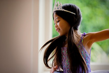 Happy Young Girl Wearing Pigtails And A Tiara.