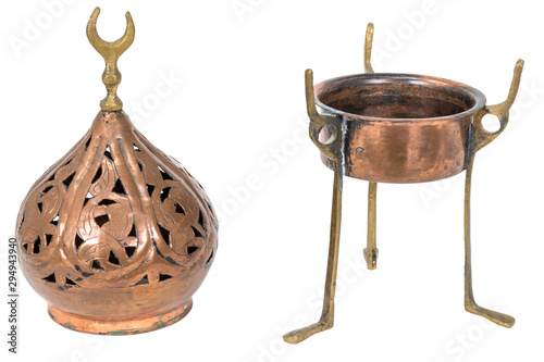 Fényképezés Old oriental incense burner made of copper isolated on white
