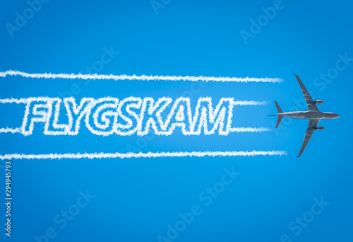 Photo Airplane leaving jet contrails with Flygskam word inside