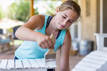 13 Year Old Girl Painting Outdoor Furniture White