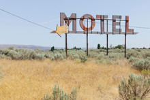Vintage Motel Sign With Dry Scrub-land In Foreground, Whitman County, Palouse, Washington, USA.