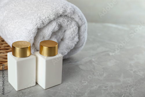 Photo sur Toile Pays d Asie Composition with cosmetic products on grey stone table, space for text. Spa therapy
