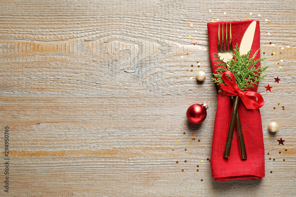 Fototapeta Cutlery set on wooden table, top view with space for text. Christmas celebration