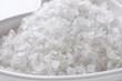 Leinwandbild Motiv Natural white sea salt in bowl, closeup view. Spa treatment
