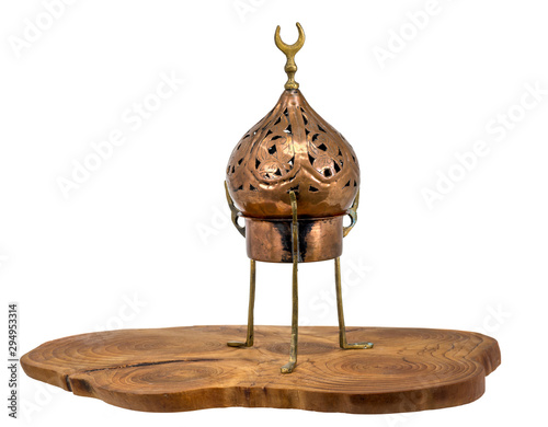 Slika na platnu Old oriental incense burner made of copper stands on a wooden disc